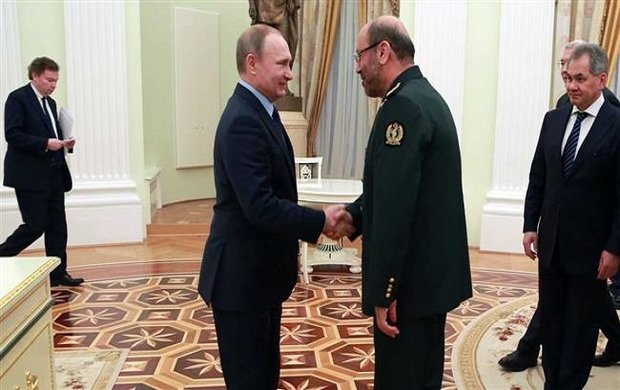 Defense min., Russia's Putin confer on regional coop.