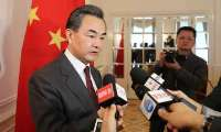 Chinese FM urges use of Iran model for resolution of North Korea nuclear issue