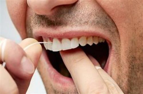 نخ دندان استفاده کنیم یا نه؟